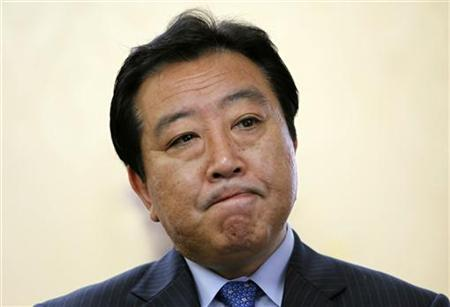 Japan's newly appointed Finance Minister Yoshihiko Noda reacts during a group interview at the ministry in Tokyo